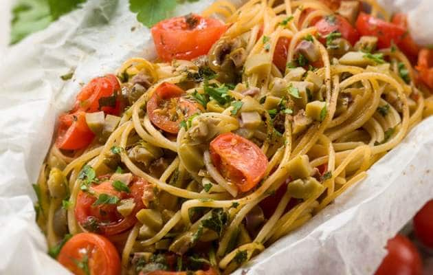 spaghetti with cherry tomatoes and green olives, selective focus
